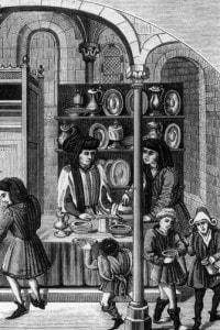 Mercato coperto medievale nel 1400. I prodotti in vendita sono principalmente scarpe e stoviglie