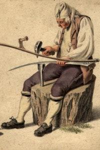 Un artigiano che forgia la lama di una falce, 1880 circa