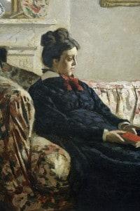 Madame Monet seduta sul divano, di Claude Monet