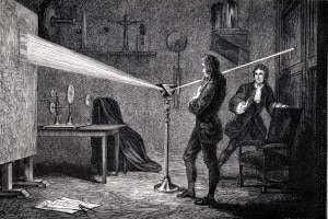 Isaac Newton usa un prisma per separare la luce bianca nei colori dello spettro