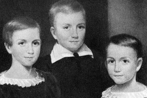 Emily Dickinson da bambina con i suoi fratelli. Da sinistra a destra: Emily, Austin, Lavinia