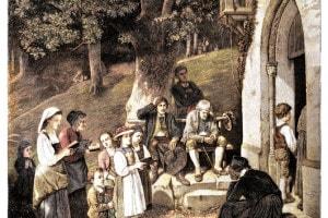 Pellegrini che pregano davanti ad una Cappella