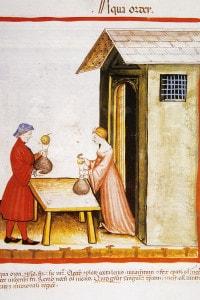 Miniatura medievale: una donna che si occupa della vendita del decotto d'orzo